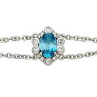 Silver Rosette Design Bracelet with Oval Sea Blue CZ